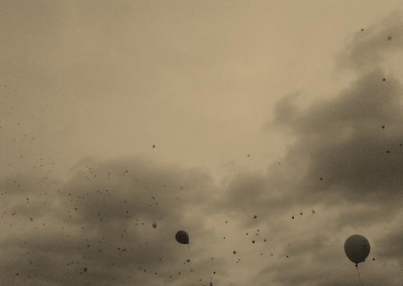 Balloons spiraling heavenwards.